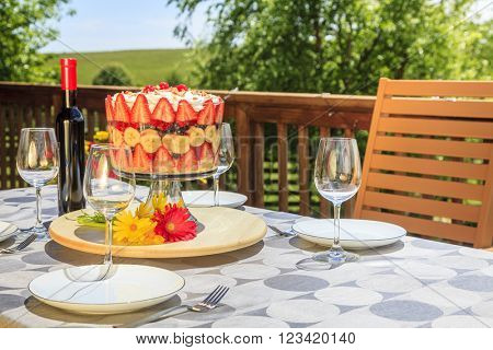 Outdoor patio table setting with trifle and wine