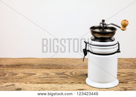 Vintage coffee grinder and coffee beans on wooden background. poster