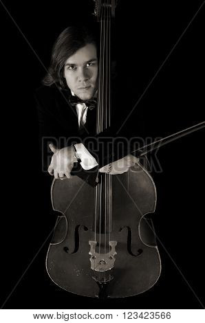 Reverie contrabass musician over black background in sepia
