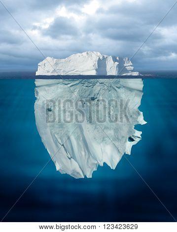 A Mostly Underwater Iceberg Floating in Ocean