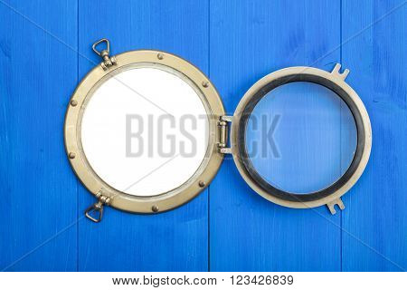 Opened vintage brass porthole, aperture isolated with clipping path