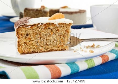 Piece of carrot cake and fork on a plate