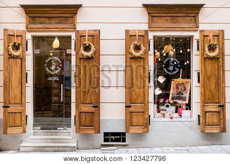 Lviv Ukraine Europe - February 2016: Picturesque nook windows of street cafe Workshop marzipan in old town Lviv.