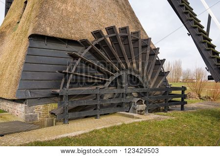 Closeup of the water wheel of a large Dutch wooden hollow post mill. The mill a national monument was originally built in 1795 and later partly burnt down and completely restored.