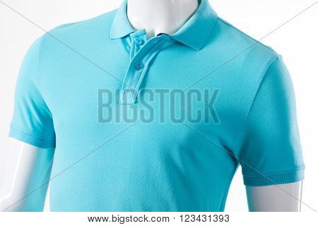Light blue t-shirt on mannequin. Male mannequin in polo t-shirt. Casual light garment for men. T-shirt sale at local store.