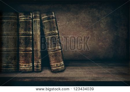 Vintage background with old books on a shelf and copy space