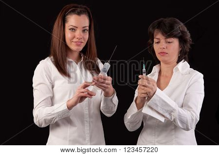 Female Doctor And Hurse Preparing To Give An Injection