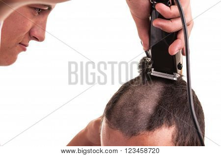 Barber cutting hair with clipper on white poster