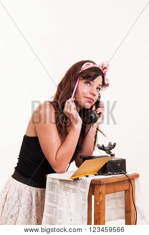 thinker beautiful and fashion young woman with a retro look speaking at a phone