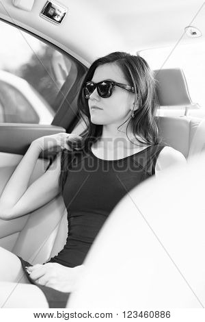 beautiful business woman in the car with glasses