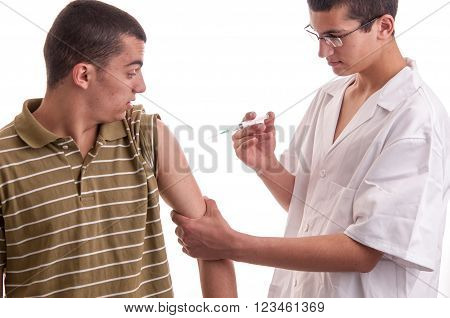 Young Doctor Give An Injection To A Pacient Who Is Very Afraid Of Needles