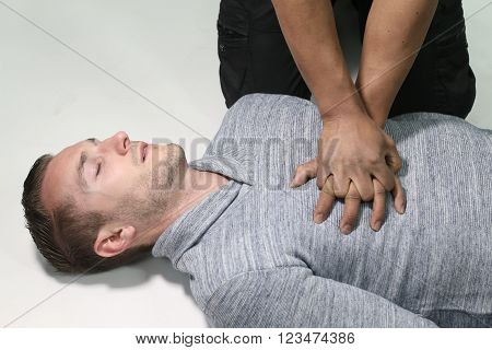 man doing a CPR over a white background