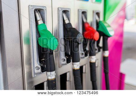 Fuel dispenser at a gasoline station. Green, red, black