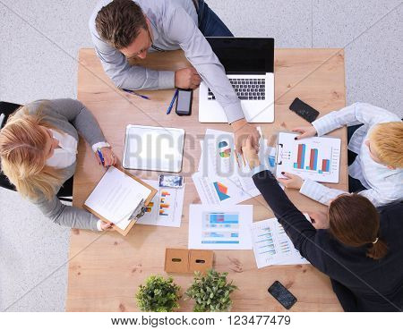 Group of business people working together on white background. ** Note: Soft Focus at 100%, best at smaller sizes
