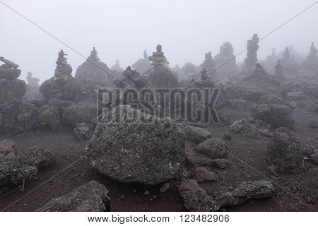 Stone piramids in fog, Machame route, Kilimanjaro