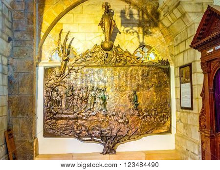 BETHLEHEM PALESTINE - FEBRUARY 18 2016: The bronze relief of the Tree of Jesse in the Church of St. Catherine on February 18 in Bethlehem.