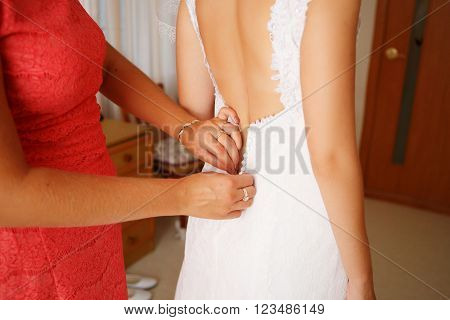 Dressing Up The Bride On Wedding-day.
