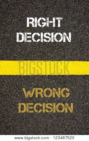 Antonym decision concept of WRONG DECISION versus RIGHT DECISION written over tarmac, road marking yellow paint separating line between words