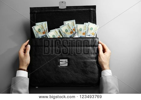 Businessman and brief case with money