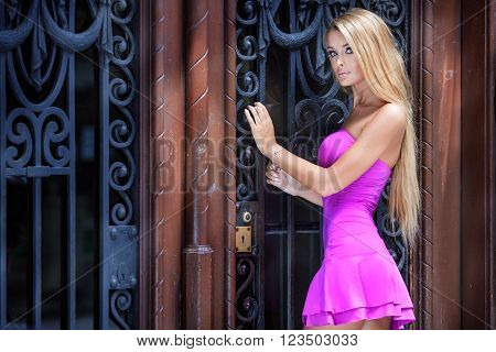 Blonde Woman In Pink Dress.