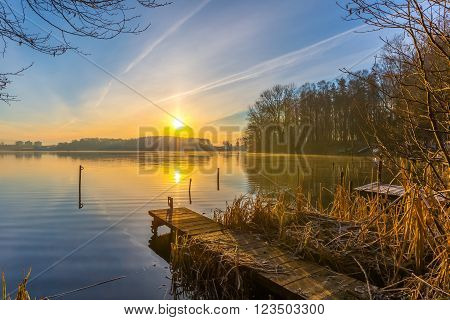 Sunrise Over Lake At End Of Winter