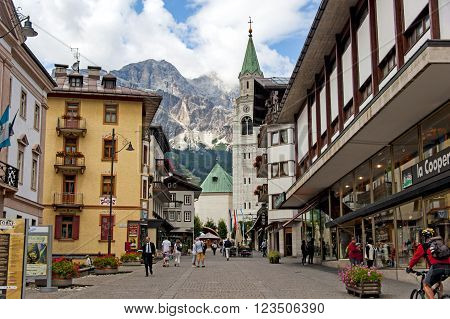 Cortina d'Ampezzo, Italy - September 6, 2012: People are walking down the main street of alpine resort of Cortina d'Ampezzo in the Italian Dolomites
