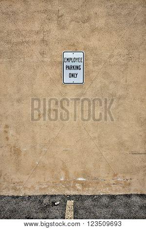Employee Parking Sign in Empty Parking Spot