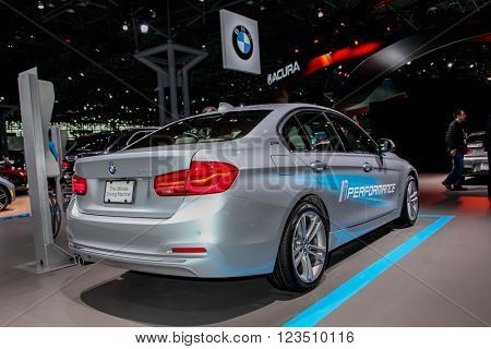 NEW YORK - March 23: A BMW 330e Sedan exhibit at the 2016 New York International Auto Show during Press day,  public show is running from March 25th through April 3, 2016 in New York, NY.