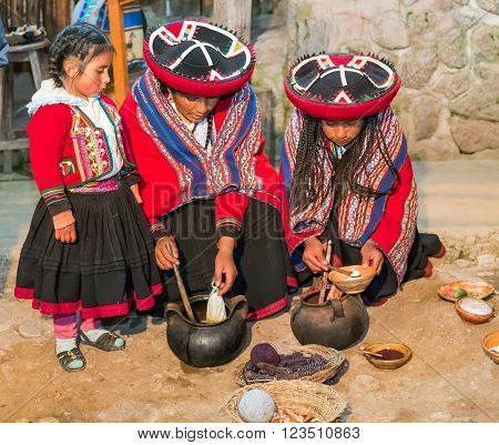 Ollantaytambo, Peru - Circa June 2015: Women In Traditional Peruvian Clothes Use Natural Dyes For Al