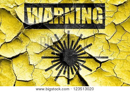 Grunge cracked Laser warning sign with some soft spots and highlights