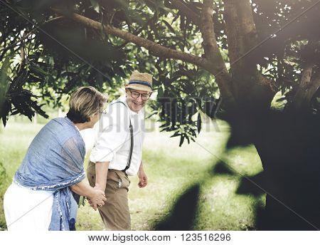 Senior Adult Couple Love Romance Nature Park Concept