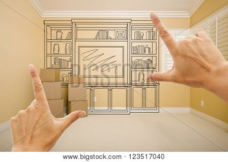 Hands Framing Drawing of Entertainment Unit In Empty Room With Moving Boxes.