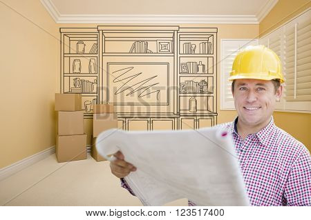 Male Construction Worker Wearing Hard Hat In Room With Drawing of Entertainment Unit On Wall.