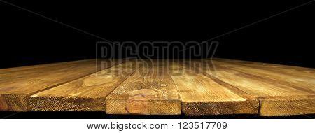 Old  wooden desk on black background
