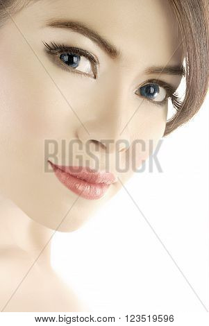 Beauty shot or head shot of asian female model with proper makeup in her face