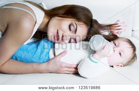 beautiful young mother and her one year old baby at home