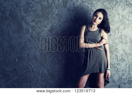 beautiful young teenage model wearing a dress  in the studio