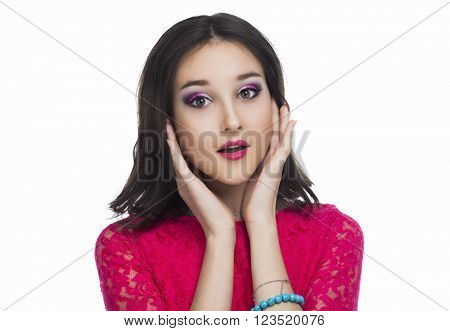 surprised teenage girl isolated against white studio background