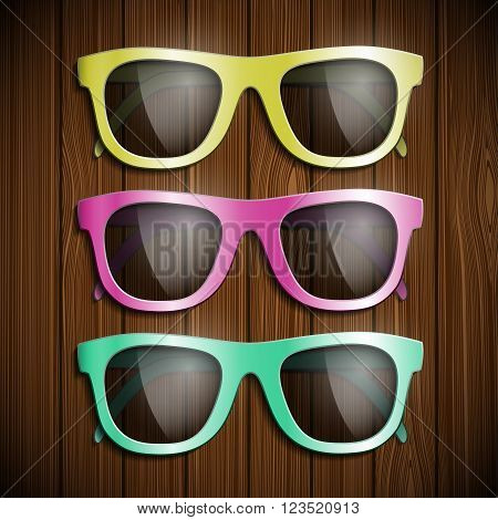 Set of colored glasses on a wooden surface. Symbol of glamor and hipster. Stock vector illustration.
