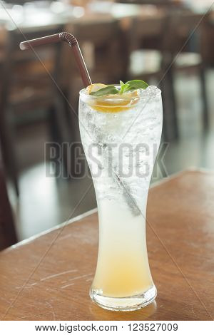 Glass of iced honey lemon soda, stock photo