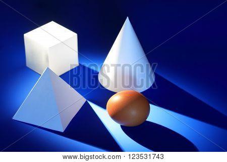 Diversity concept. Set of various paper shapes near egg on blue background