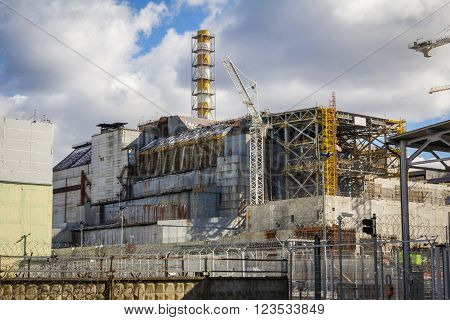 UKRAINE, PRYPIAT - MARCH 19, 2016: Chernobyl Nuclear Power Plant and shelter facility. Front view