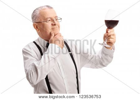 Satisfied senior gentleman tasting some fine red wine isolated on white background