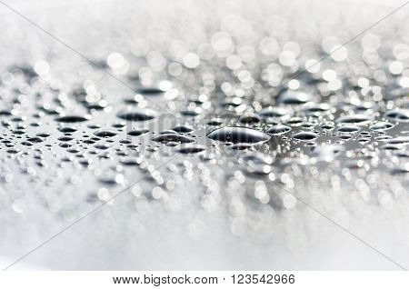 drops on the glass surface of the matrix TFT monitor closely background