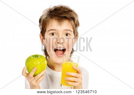 Smiling nine year old boy going to drink fresh apple juice. Isolated over white.
