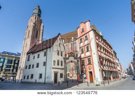 Wroclaw, Poland - Circa March 2012: Clock Tower Of St. Elisabeth Church And Jas And Malgosia Buildin