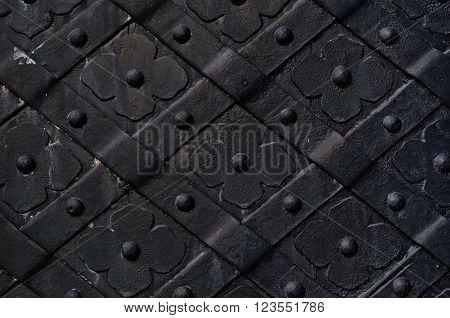 Dark gray door made of wrought iron