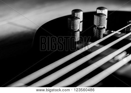 Body of a classic black bass guitar