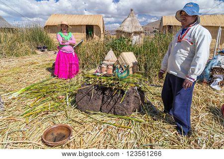 Puno, Peru - Circa June 2015: Family At Uros Floating Island And Village On Lake Titicaca Near Puno,