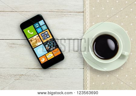 Coffee cup and Mobile phone on wood table with Social Media concept.